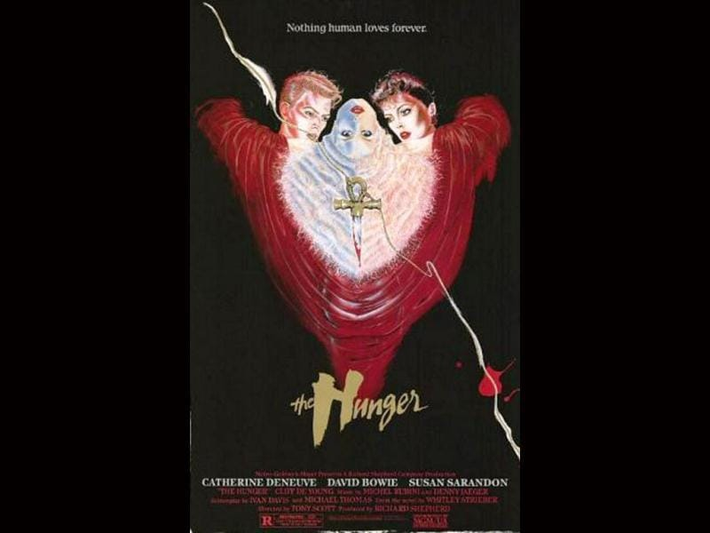 This horror film, released in 1983, marked the directorial debut of Tony Scott. It is the story of a love triangle between a doctor, played by Susan Sarandon who specializes in sleep and aging research and a vampire couple, played by Catherine Deneuve and David Bowie.