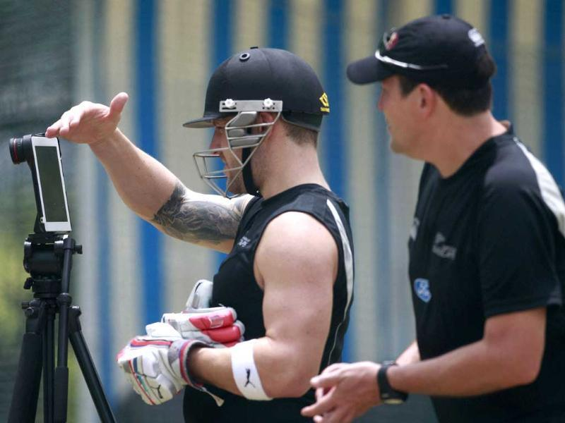 New Zealand cricketer Brendon McCullum, looks at a speed monitor during a practice session at Rajiv Gandhi International Cricket Stadium in Hyderabad before the two test cricket series between India and New Zealand. PTI