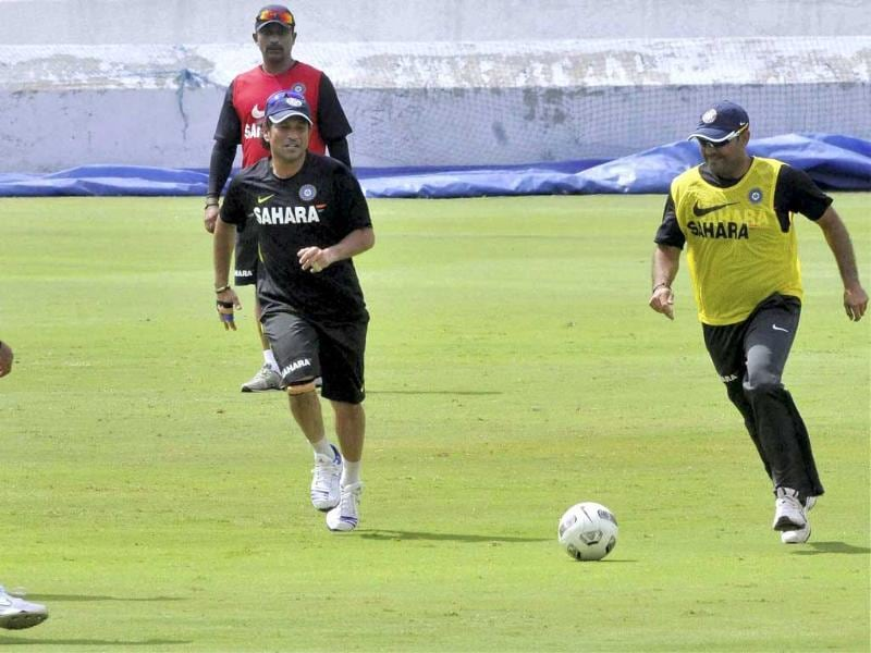 Sachin Tendulkar and Virender Sehwag playing football during a practice session in Hyderabad ahead of the first cricket test match against New Zealand. PTI