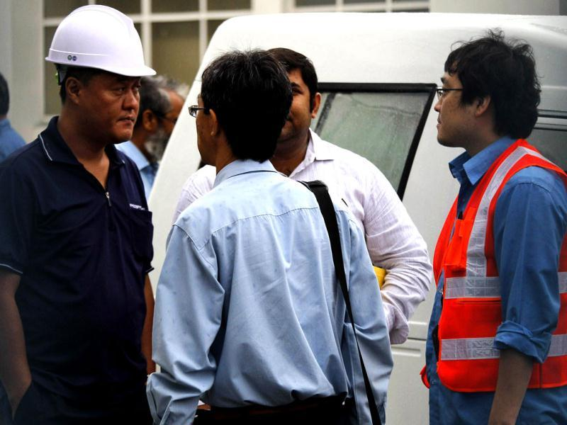 Japanese members of the management huddle at the Maruti Suzuki factory in Manesar. AP Photo