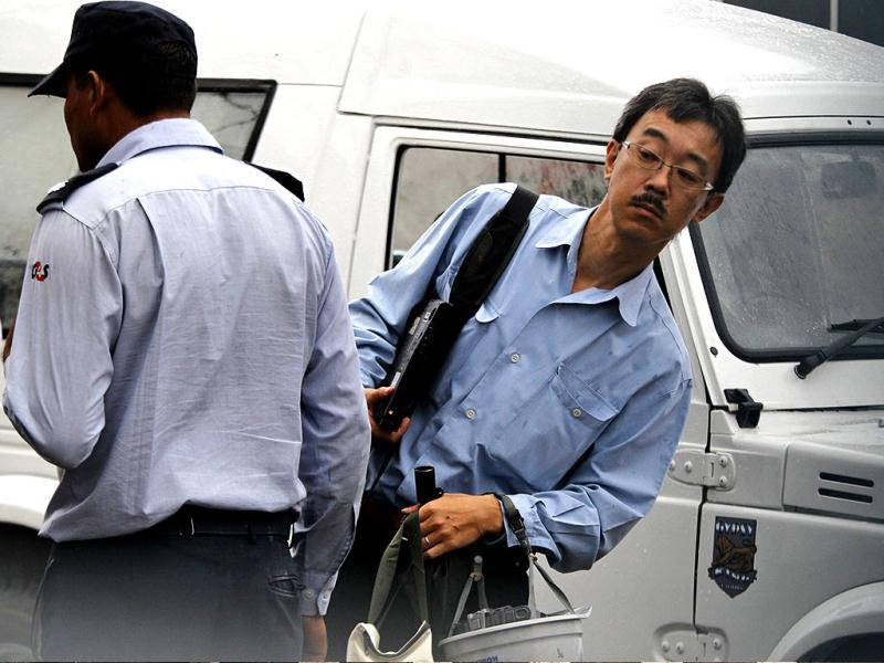 An unidentified Japanese worker arrives at the Maruti Suzuki factory in Manesar. AP Photo