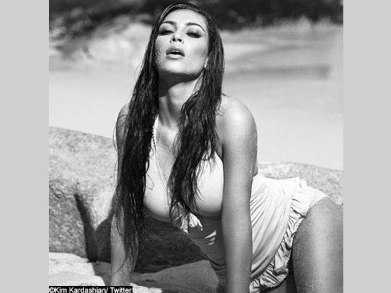 Kim Kardashian oozed oomph, as she posed in a bikini on a beach. Check out the beauty at her hottest best.