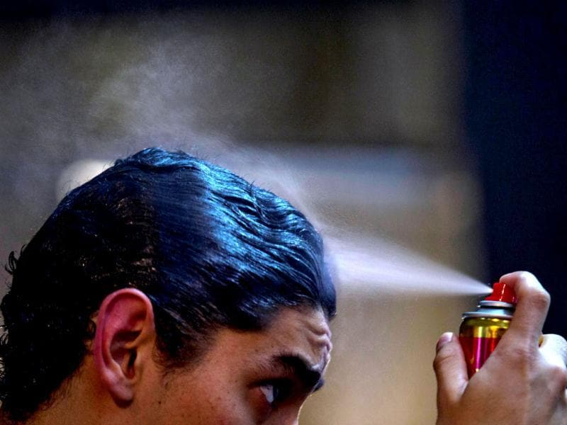 Participant Ramiro Perez sprays his hair before competing. Hundreds of professional dancers compete in the championship and teach many the eight basic steps of the dance in the city where it was born. AP/Natacha Pisarenko