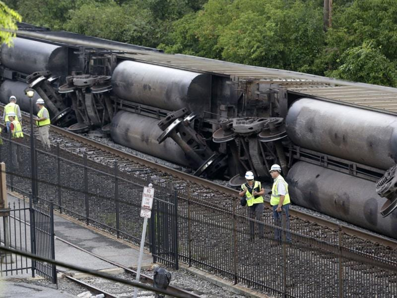 Officials stand near part of a CSX freight train that derailed overnight in Ellicott City, Md.,. (AP Photo/Patrick Semansky)