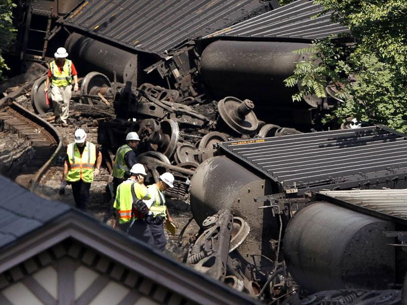 Workers assess the wreckage of an overturned freight train in Ellicott City, Maryland. Reuters/Jonathan Ernst