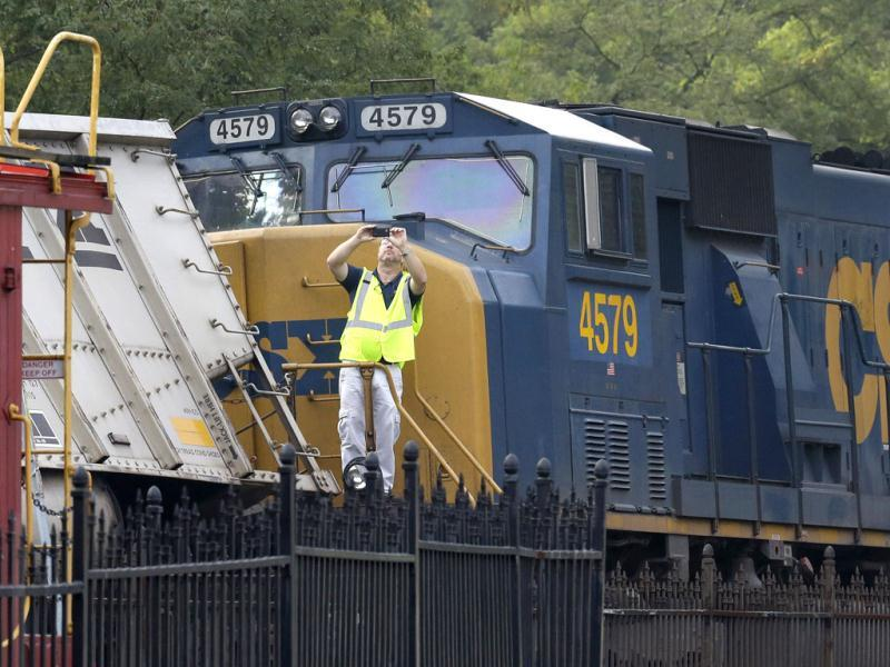 An official photographs derailed train cars after a CSX freight train hauling coal derailed overnight in Ellicott City, Md. (AP Photo/Patrick Semansky)