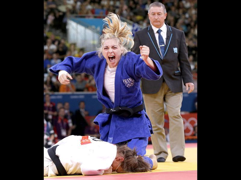 France's Automne Pavia celebrates after defeating Hungary's Hedvig Karakas in their women's -57kg bronze medal B judo match at the London 2012 Olympic Games. Reuters Photo