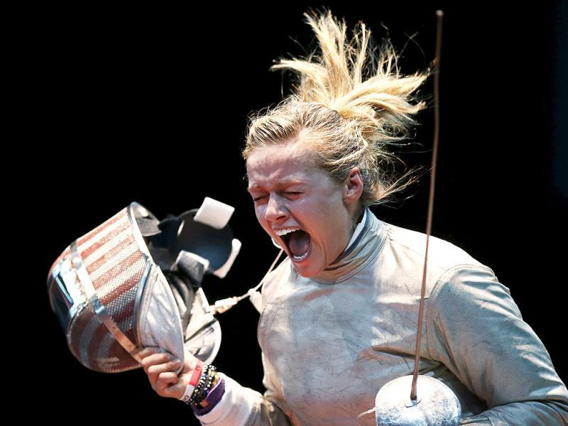 Dagmara Wozniak of the US celebrates her victory against Tunisia's Azza Besbes during their women's sabre individual round of 16 fencing competition at the ExCel venue at the London 2012 Olympic Games. Reuters Photo
