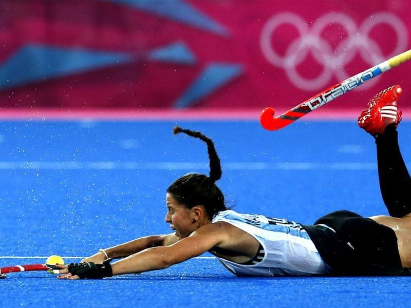 Argentina's Sofia Maccari falls on the pitch during their women's gold medal hockey match against Netherlands at the Riverbank Arena at the London 2012 Olympic Games. Reuters Photo