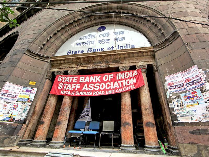 A SBI branch wears a deserted look in Kolkata. Employees of public sector banks have begun a two-day nationwide opposing banking sector reforms and outsourcing of non-core activities, affecting operations. PTI photo/Swapan Mahapatra