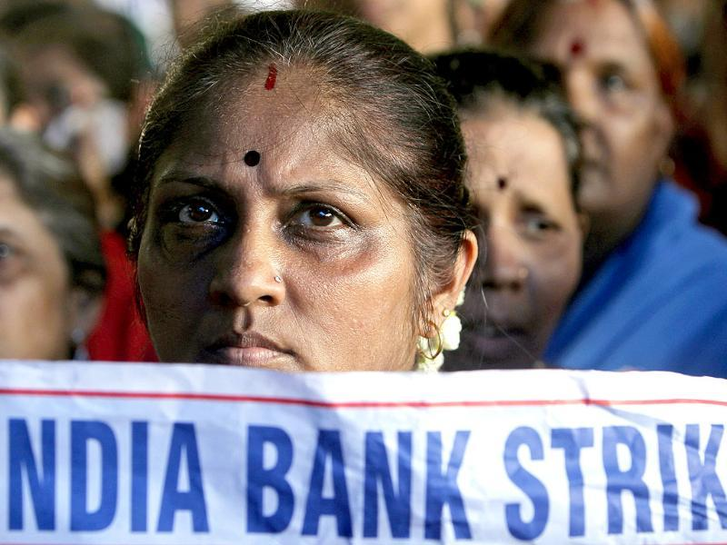 A bank employee holds a placard as she participates in a protest during a two-day strike in Mumbai. (AP File Photo)