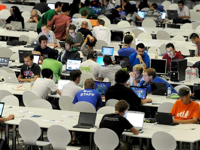 "Young people work on their computers as they take part in the Campus Party Europe electronic entertainment event in Berlin. The weeklong, 24-hours-a-day technology festival for thousands of ""campuseros"" - hackers, developers, gamers and geeks is running until August 26, 2012. Equipped with computers and other toys, participants camp on-site and immerse themselves in their technical environment.  AFP PHOTO / BRITTA PEDERSEN"