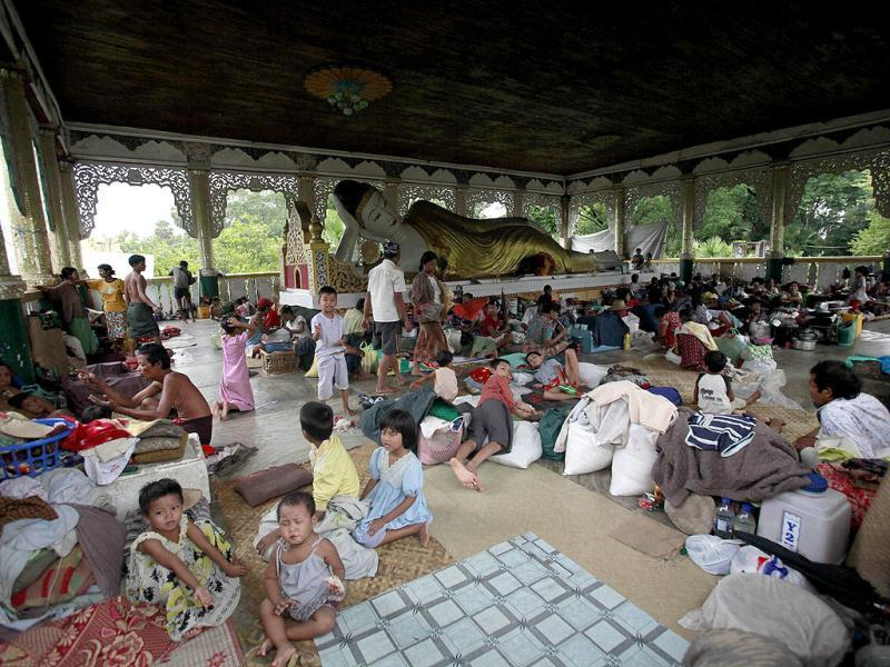Flood-affected people resting at a temple used as a temporary shelter in Pathein, in the Irrawaddy delta region of Myanmar. AFP Photo