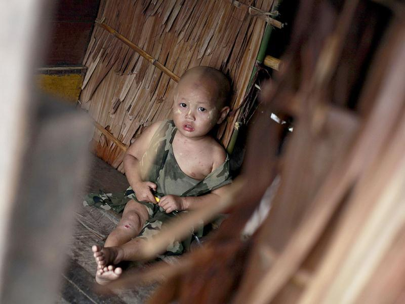 A flood-affected child resting at a temporary shelter set up on high ground outside Pathein, in the Irrawaddy delta region of Myanmar. AFP Photo