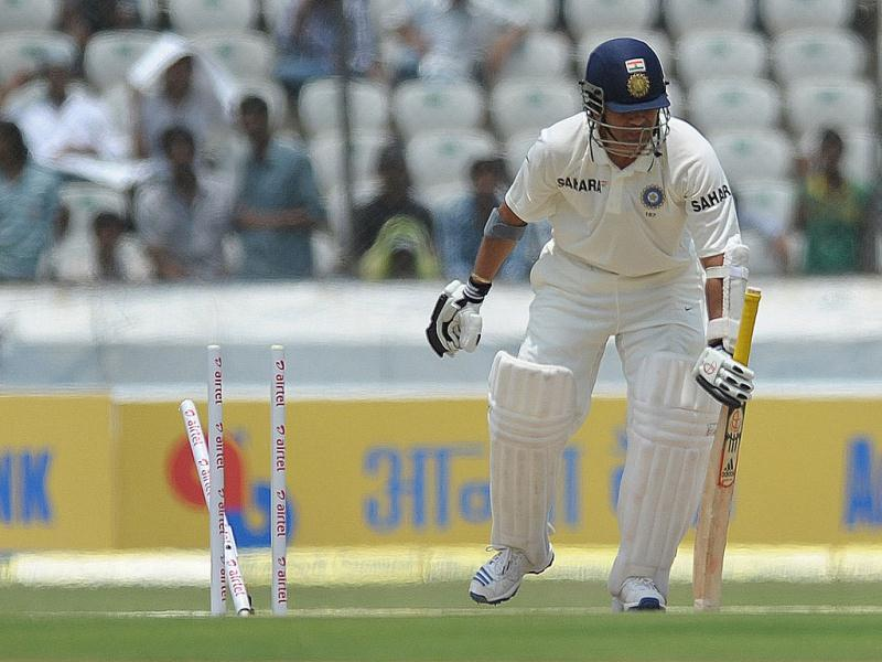 Sachin Tendulkar is bowled during the opening day of the first Test match against New Zealand at the Rajiv Gandhi International cricket stadium in Hyderabad. (AFP Photo/ Noah Seelam)