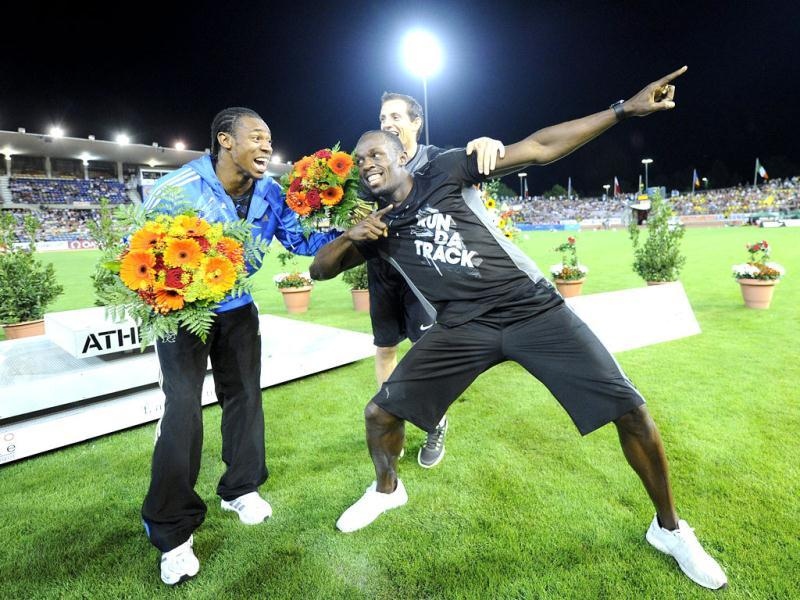 Jamaica's Yohan Blake, Jamaica's Usain Bolt and France's Renaud Lavillenie, from left, celebrate at the Athletissima IAAF Diamond League athletics meeting in the Stade Olympique de la Pontaise in Lausanne, Switzerland. (AP Photo)