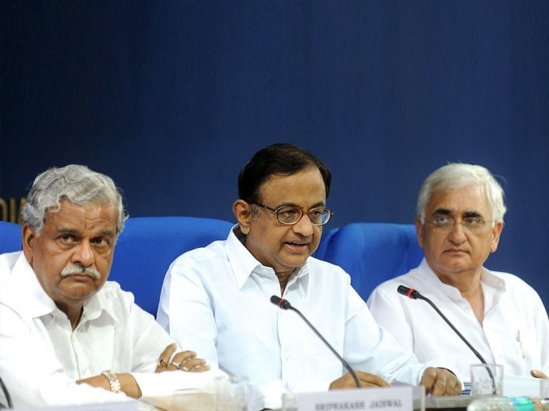 Finance minister P Chidambaram speaks as coal minister Sriprakash Jaiswal and law minister Salman Khurshid look on during a joint press conference in New Delhi. Chidambaram appealed to the opposition to
