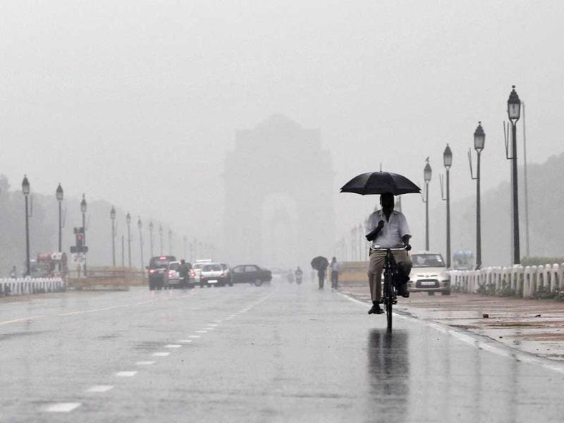 A man holds an umbrella whilst cycling as it rains in New Delhi. The monsoon rains were 2% below average in the week to August 22. Reuters/Adnan Abidi
