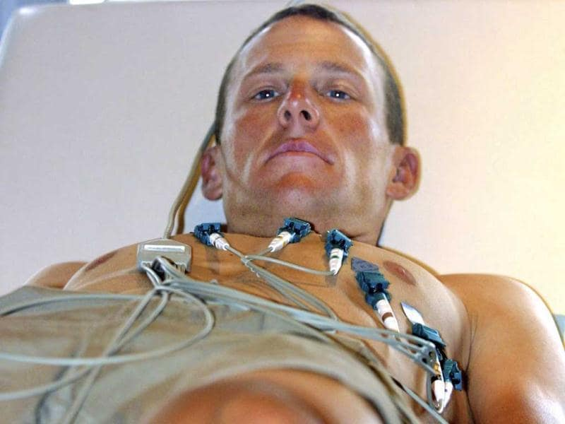 Seven-time Tour de France winner Lance Armstrong looks up from the examination table during the Tour de France cycling race medical visit in this 2001 file picture. Reuters photo