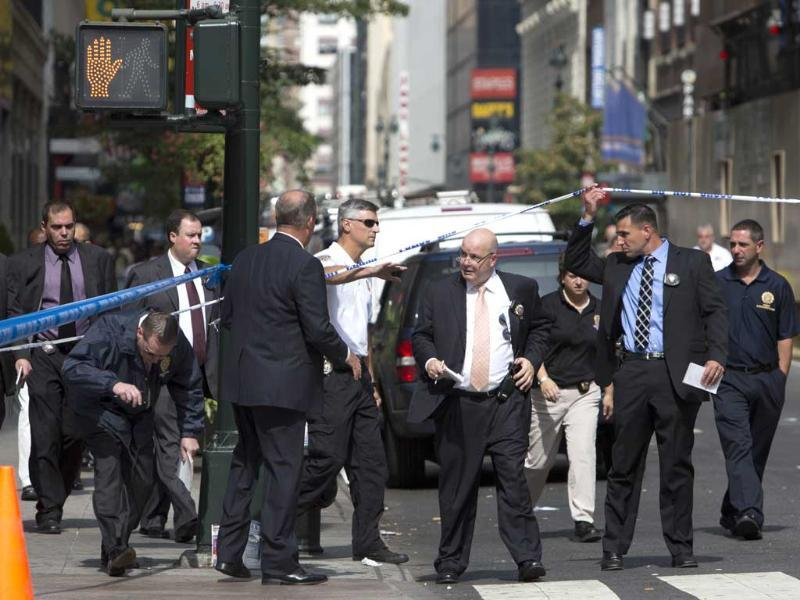 Law enforcement enters the scene of shooting near the Empire State Building in New York City. AFP/Andrew Kelly