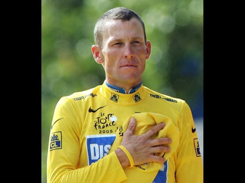 Seven time Tour de France champion Lance Armstrong of the US stands with hand on heart during the playing of national anthems after he won his seventh straight Tour de France in Paris, in this 2005 file photo. Reuters photo
