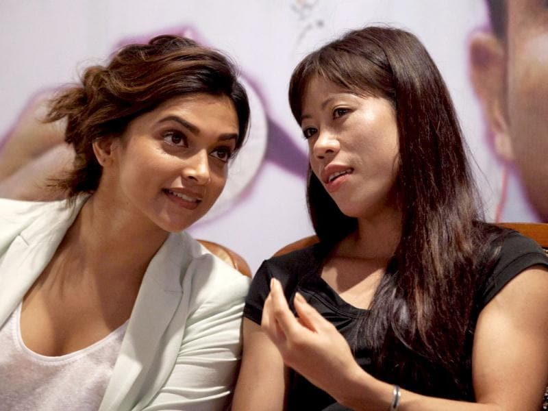 Bollywood actor Deepika Padukone and Mary Kom talk to each other during the felicitation conference for Olympic medalists Mary Kom and Vijay Kumar, organised by the Bombay Gymkhana Club. Deepika is quite interested in sports and her father Prakash Padukone is a veteran badminton player.
