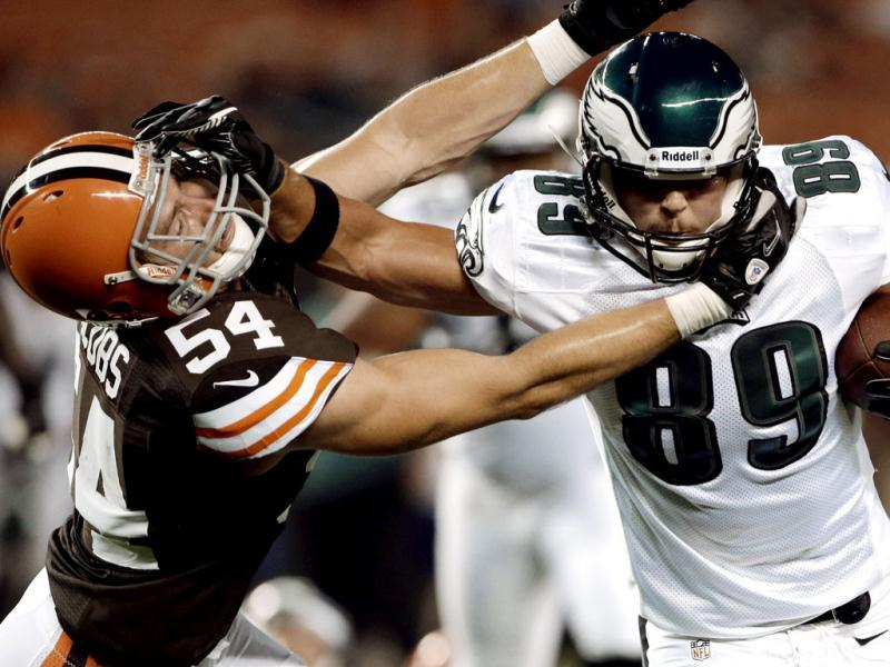 Philadelphia Eagles tight end Chase Ford (89) fights off Cleveland Browns linebacker Ben Jacobs (54) after a pass reception in the fourth quarter of an NFL preseason football game in Cleveland. The Eagles won 27-10. AP/Mark Duncan