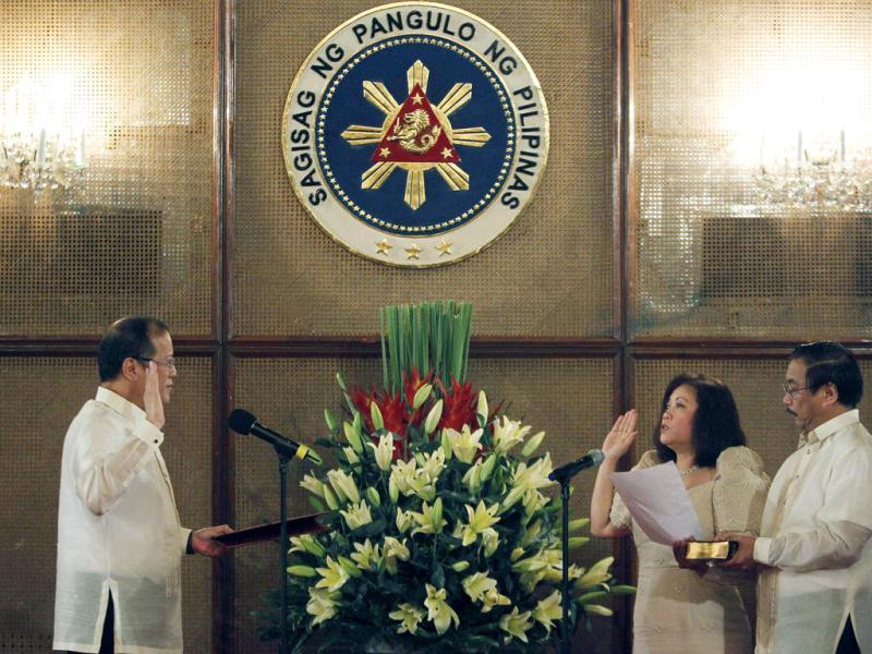 Philippines President Benigno Aquino III administers the oath to his newly appointed Supreme Court of the Philippines Chief Justice Maria Lourdes Sereno at the Malacanang palace in Manila. Sereno, the first female chief justice of the country, replaced ousted chief justice Renato Corona. Reuters/Cheryl Ravelo