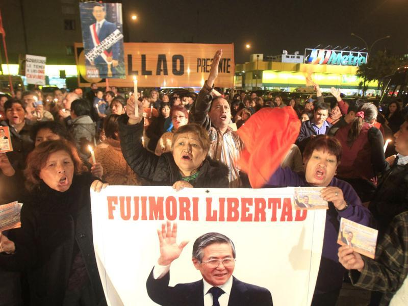 Supporters shouts slogans while holding images of former President Alberto Fujimori during a vigil after his surgery outside San Felipe Clinic in Lima. Fujimori, who is in jail for human rights charges, was successfully operated. Reuters/Enrique Castro-Mendivil