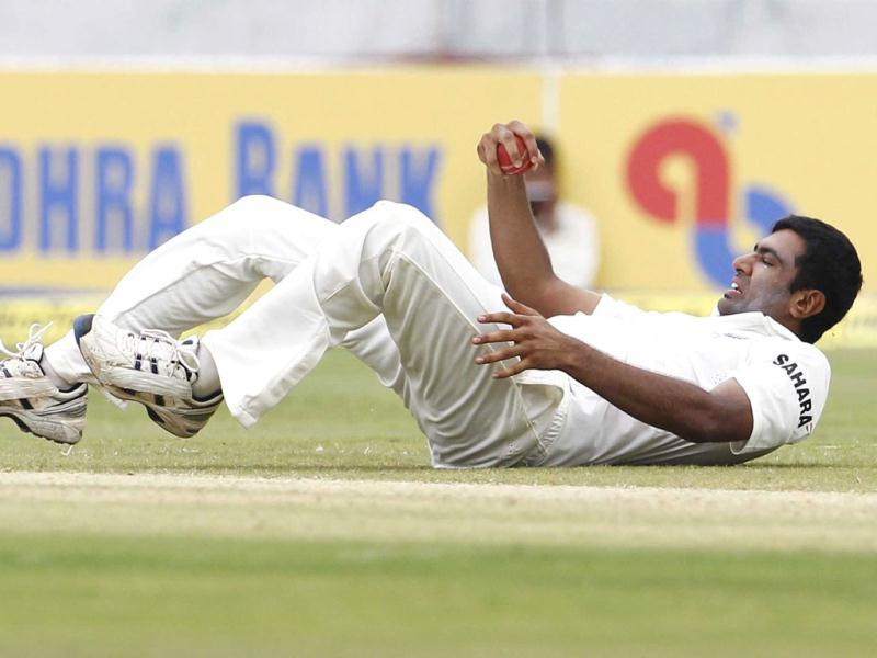India's Ravichandran Ashwin takes a catch off his own bowling to dismiss New Zealand's Jeetan Patel during the third day of their first test cricket match against New Zealand in Hyderabad. Reuters/UNI Photo-6R