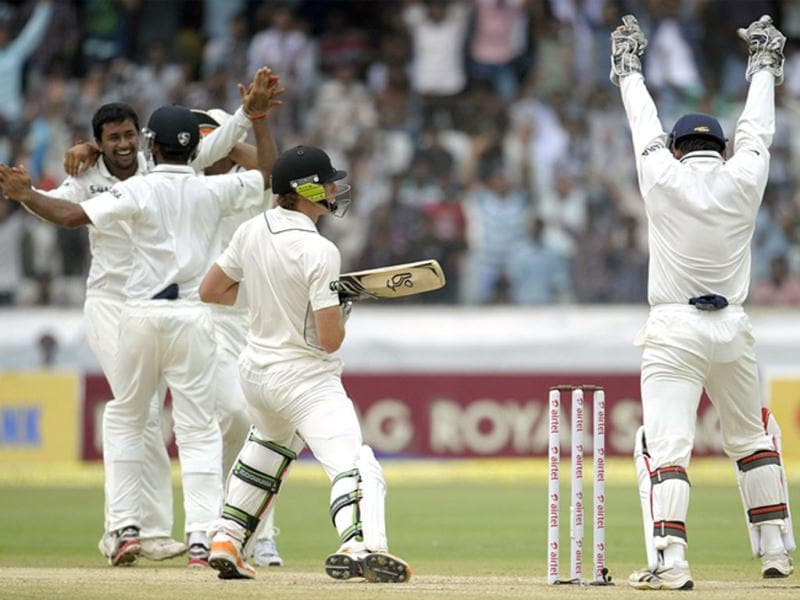 Indian cricketer Pragyan Ojha celebrates the dismissal of New Zealand cricketer Martin Guptill during the third day of the first Test match between India and New Zealand at the Rajiv Gandhi International Cricket Stadium in Hyderabad. AFP/Noah Seelam