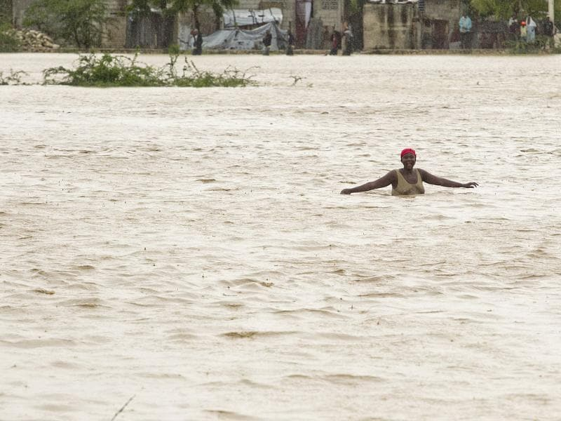 A woman wades through floodwaters in Port au Prince. Tropical Storm Isaac emerged over warm Caribbean waters slightly weaker but ready to regroup after dumping torrential rains on Haiti. Reuters/UN/MINUSTAH/Logan Abassi/Handout