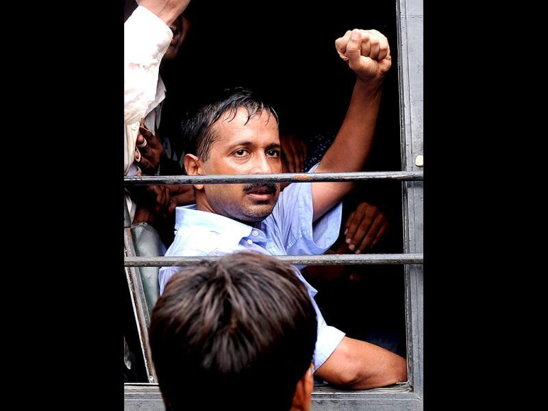 Indian activist Arvind Kejriwal sits inside a police vehicle after he was detained along with his supporters as they were marching towards the Prime Minister's residence in New Delhi. AFP Photo/Sajjad Hussain