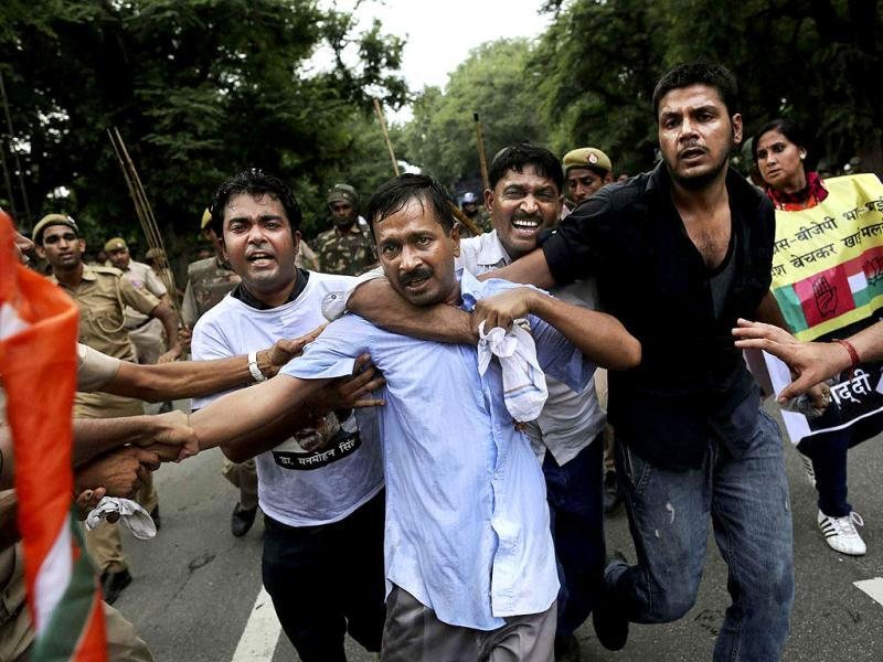 Anti-corruption activist Arvind Kejriwal and his supporters during clashes at a protest near the Prime Minister's official residence in New Delhi. PTI Photo