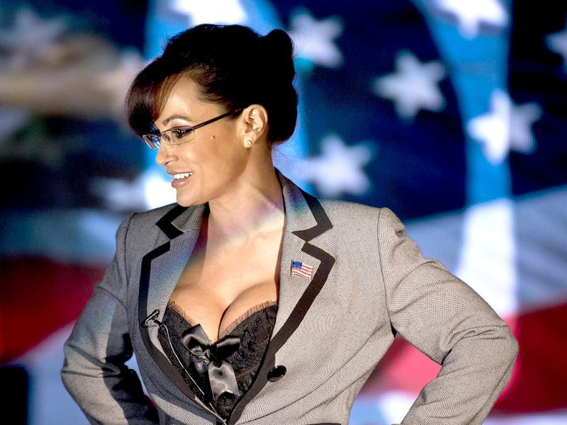 Lisa Ann, an adult film star and Sarah Palin tribute artist, gets up after speaking to members of the press at Thee DollHouse gentleman's club in Tampa, Florida. AFP Photo