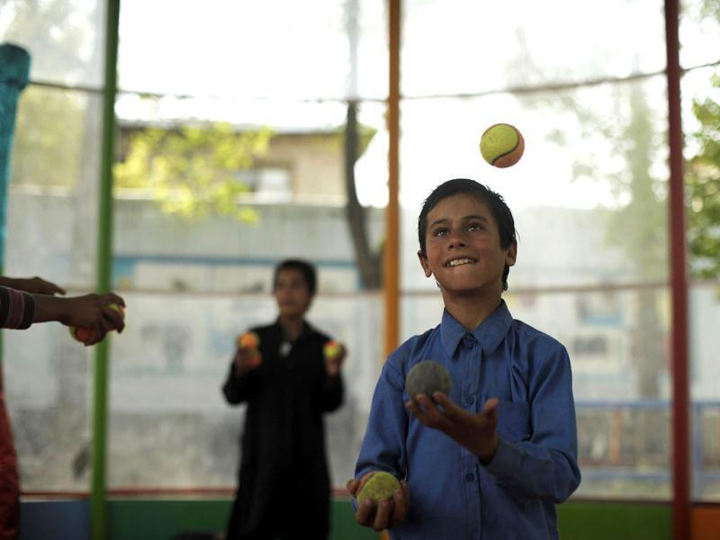 Young competitors rehearse before the 7th Afghanistan Juggling Championships in Kabul. AFP Photo/Jose Cabezas
