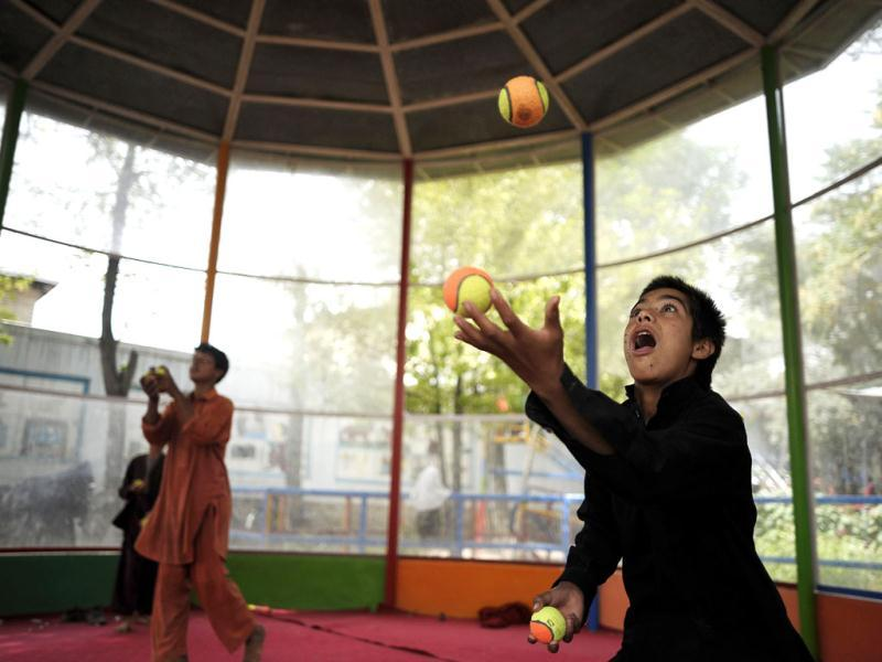 Young jugglers rehearse before the 7th Afghanistan Juggling Championships in Kabul. AFP Photo/Jose Cabezas