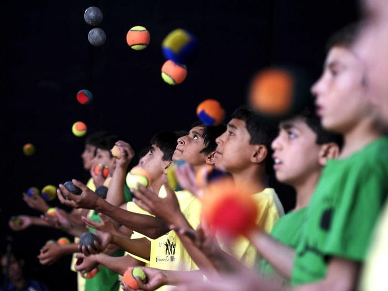 Young jugglers preform during the 7th Afghanistan Juggling Championships in Kabul. The juggling Championship, organised by the Mobile Mini Circus for Children brought together the best jugglers from different Afghan provinces for the competition. AFP Photo/ Jose Cabezas