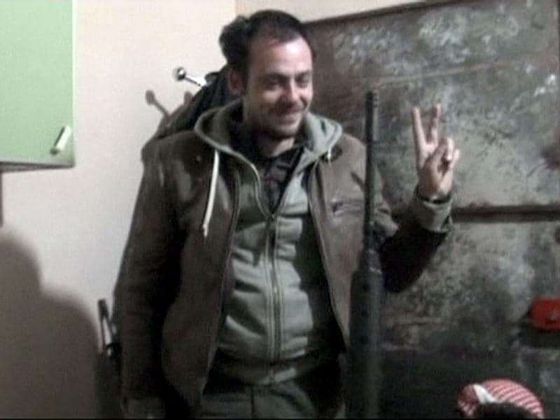 French photographer Remi Ochlik flashes a victory sign as he jokes with Syrian Free Army fighters in the last known footage of him in Homs February 22, 2012. Ochlik and American journalist Marie Colvin were killed during a Syrian forces bombardment, along with 80 more people that day. Reuters Photo