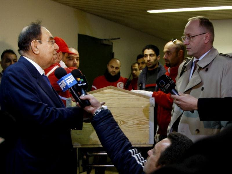 Abdul Rahman Attar chief of the Syrian Red Crescent (L) delivers to a Polish diplomat, who is managing US affairs in Syria, a casket containing the body of US journalist Marie Colvin at Al-Assad University Hospital in Damascus March 3, 2012. Reuters Photo