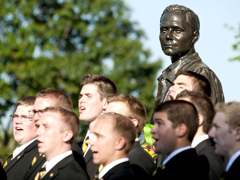 A statue of Neil Armstrong watches over the Glee Club as they sing during a memorial service for Armstrong in front of the Neil Armstrong Hall of Engineering at Purdue in West Lafayette. AP/Journal & Courier, Brent Drinkut