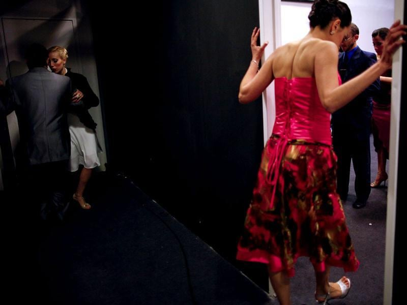 A couple warms up backstage before competing in the 2012 Tango Dance World Cup salon finals in Buenos Aires, Argentina. Argentina's annual tango competition, the highlight of a two-week festival which this year honored Astor Piazzolla, the legendary composer and bandoneonista who revived the genre and infuriated purists by blending tango with rock music in the 1970s. (AP Photo/Natacha Pisarenko)