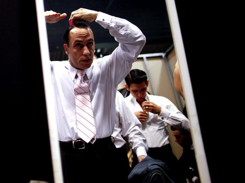 Argentina's dancer Cristian Lopez is seen reflected in a mirror as he combs his hair before competing at the 2012 Tango Dance World Cup salon finals in Buenos Aires, Argentina. Couples from around the world competed in the finals Argentina's annual tango competition, the highlight of a two-week festival which this year honored Astor Piazzolla, the legendary composer and bandoneonista who revived the genre and infuriated purists by blending tango with rock music in the 1970s. (AP Photo/Natacha Pisarenko)
