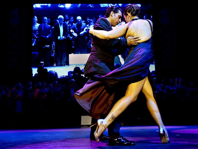 Argentina's Facundo Gomez Cross and Paola Palavecino Florence Sanz dance after winning the Tango Salon category at the Tango World Championship in Buenos Aires. AFP PHOTO / DANIEL GARCIA