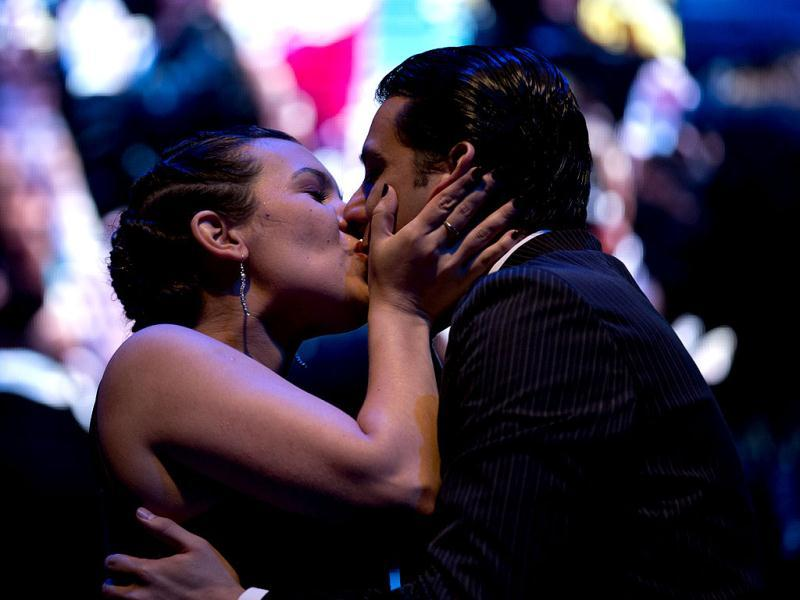 Argentina's dancers Facundo de la Cruz Gomez Palavecino, right, and Paola Sanz kiss as they celebrate after winning the 2012 Tango Dance World Cup salon finals in Buenos Aires, Argentina. Couples from around the world competed in the finals Argentina's annual tango competition, the highlight of a two-week festival which this year honored Astor Piazzolla, the legendary composer and bandoneonista who revived the genre and infuriated purists by blending tango with rock music in the 1970s.  (AP Photo/Natacha Pisarenko)