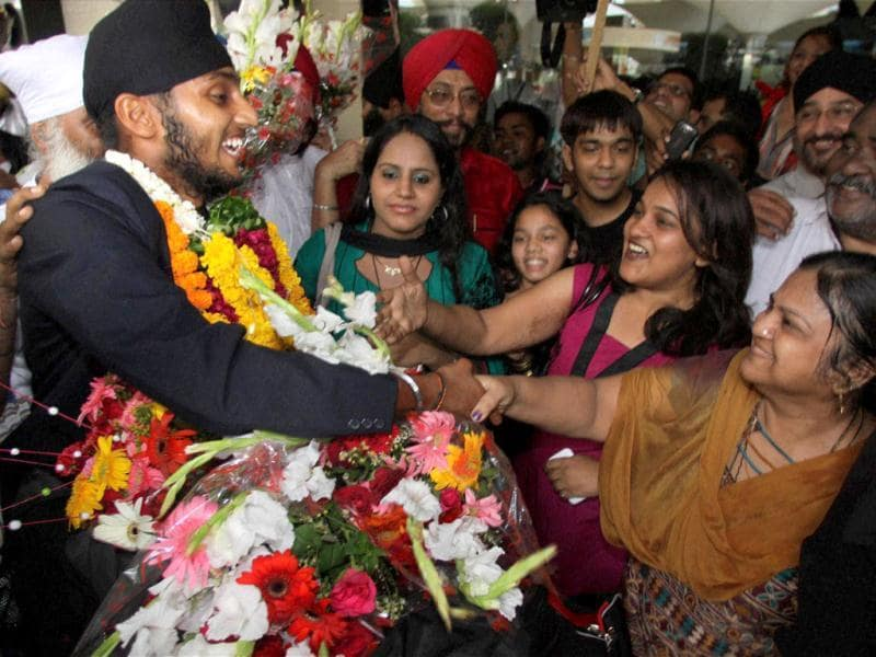 Under-19 Team India player Harmeet Singh Baddan being welcomed on his arrival at the airport in Mumbai. PTI Photo/Mitesh Bhuvad