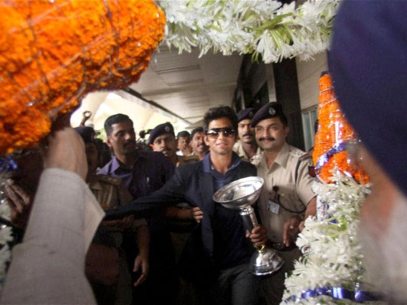 Under-19 Team India captain Unmukt Chand being welcomed on his arrival at the airport in Mumbai. PTI Photo/Mitesh Bhuvad