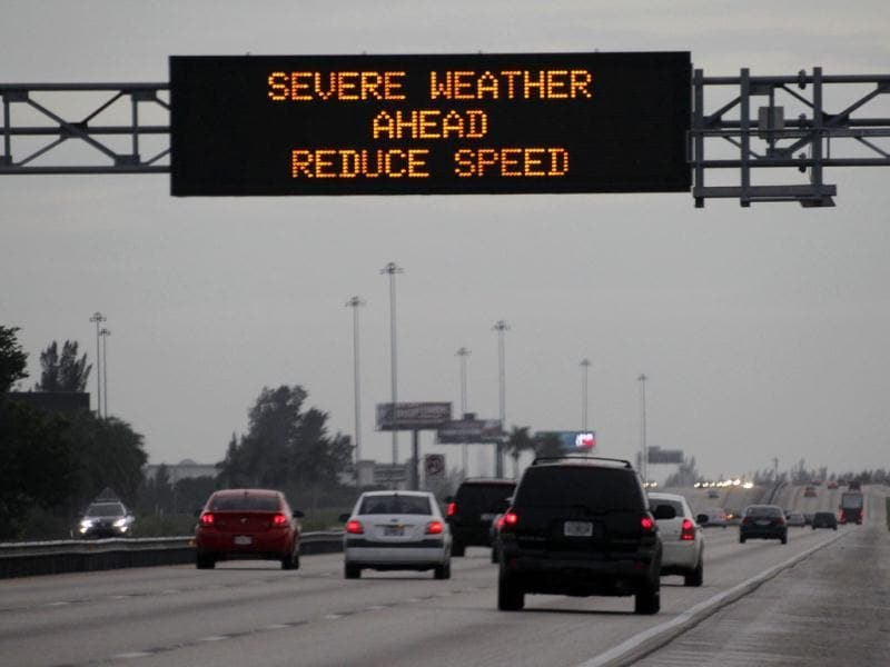 Drivers along a stretch of the Florida Turnpike slow down after passing a sign warning of severe weather caused by hurricane Isaac in Hialeah, Florida. AP Photo