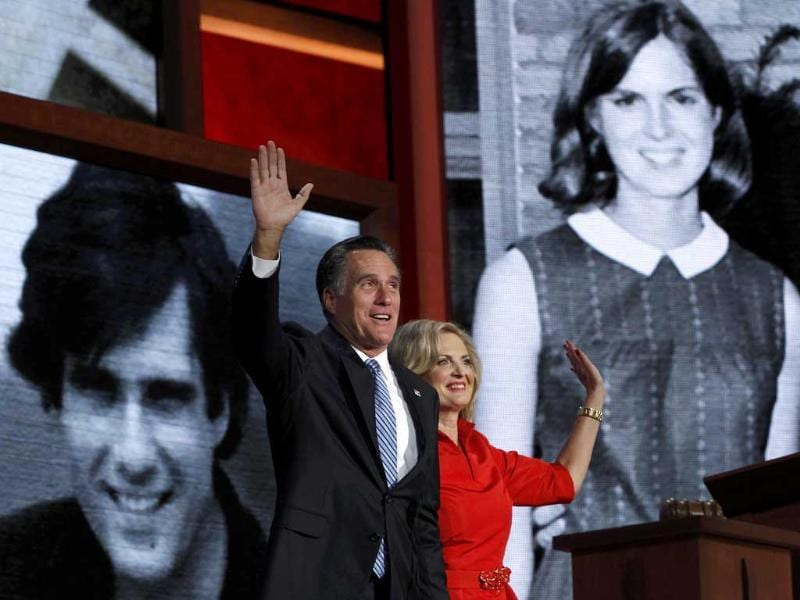 Ann Romney and her husband, Republican presidential candidate Mitt Romney, wave in front of family pictures shown on large screens after she addressed delegates during the second session of the Republican National Convention in Tampa, Florida. Reuters/Shannon Stapleton