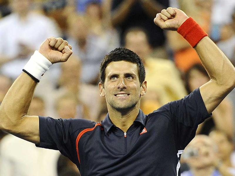 Serbia's Novak Djokovic celebrates after defeating Italy's Paolo Lorenzi in their men's 2012 US Open first round match at the USTA Billie Jean King National Tennis Center in New York. AFP/Emmanuel Dunand